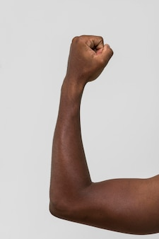 Black person holding fist up