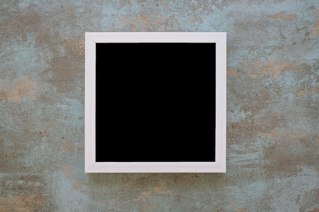 Black picture frame on grunge wall