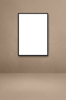 Black picture frame hanging on a beige wall. blank mockup template