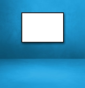 Black picture frame hanging on a blue wall. blank mockup template