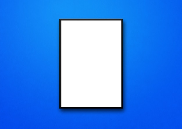 Black picture frame hanging on a blue wall.