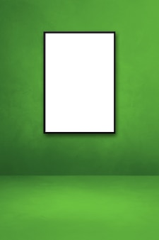 Black picture frame hanging on a green wall. blank mockup template
