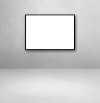 Black picture frame hanging on a light grey wall. blank mockup template