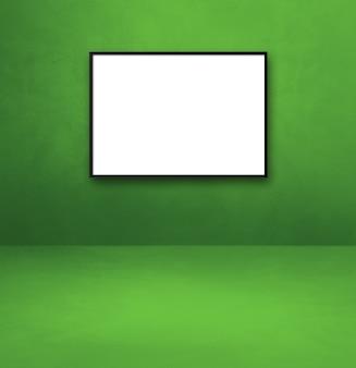 緑の壁に掛かっている黒い額縁。空白のモックアップテンプレート