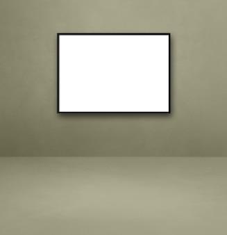 灰色の壁に掛かっている黒い額縁。空白のモックアップテンプレート