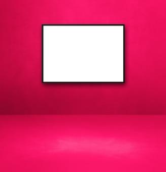 ピンクの壁に掛かっている黒い額縁。空白のモックアップテンプレート