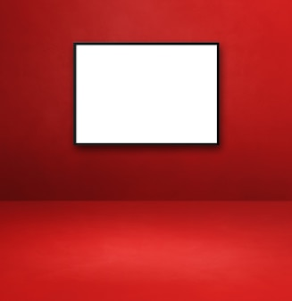 赤い壁に掛かっている黒い額縁。空白のモックアップテンプレート