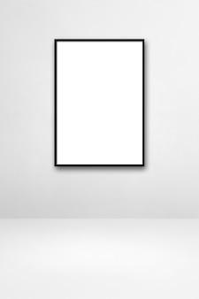 白い壁に掛かっている黒い額縁。空白のモックアップテンプレート