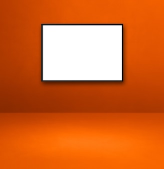 Black picture frame hanging on an orange wall. blank mockup template