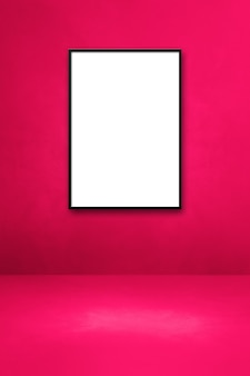 Black picture frame hanging on a pink wall. blank mockup template
