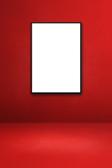 Black picture frame hanging on a red wall. blank mockup template