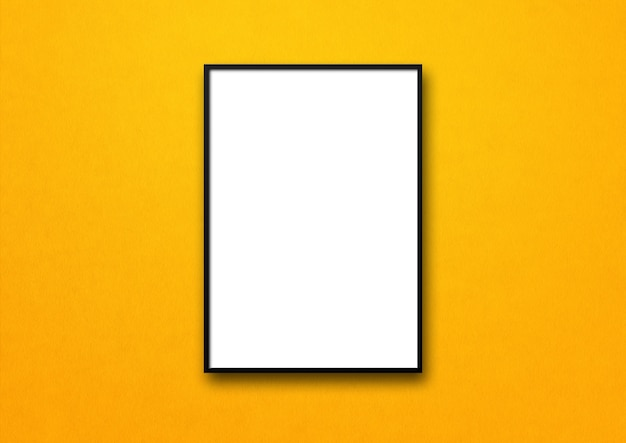 Black picture frame hanging on a yellow wall. Premium Photo