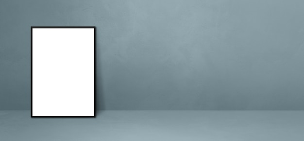 Black picture frame leaning on a grey wall. blank mockup template. horizontal banner