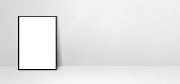 Black picture frame leaning on a white wall. blank mockup template. horizontal banner
