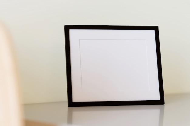 Black picture frame on table. 3d render.