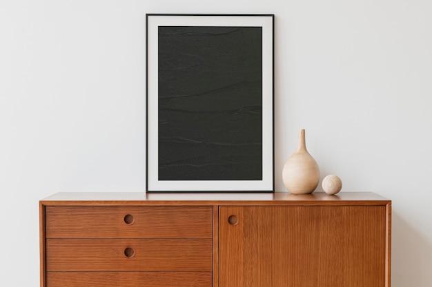 Black picture frame on wooden cabinet