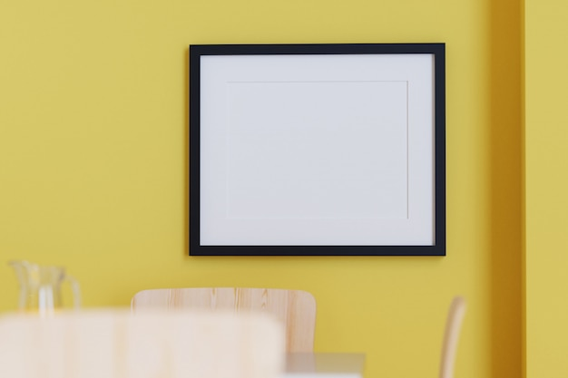 Black picture frame on the yellow wall. 3d render.