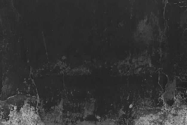 Черная поверхность штукатурки с трещинами