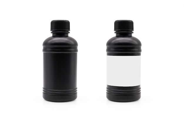 Black plastic bottle and black lid on isolated background with clipping path.
