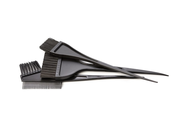 Black plastic brush for hair coloring isolated on white background, close up