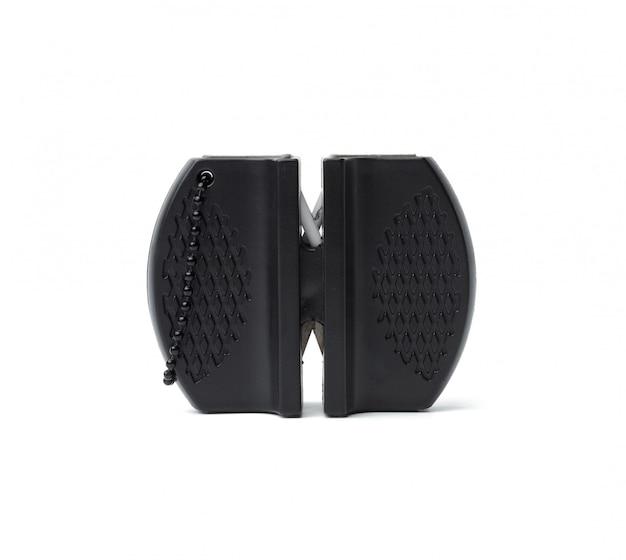 Черная пластиковая точилка для ножей на белом фоне