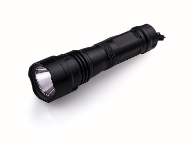 Black  police flashlight isolated on white wall.