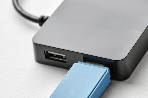 Black portable usb hub for four connections with usb flash drive
