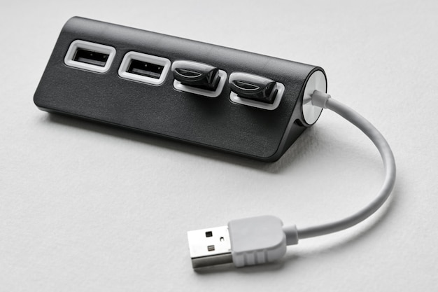 Black portable usb hub for four connections with usb flash drives