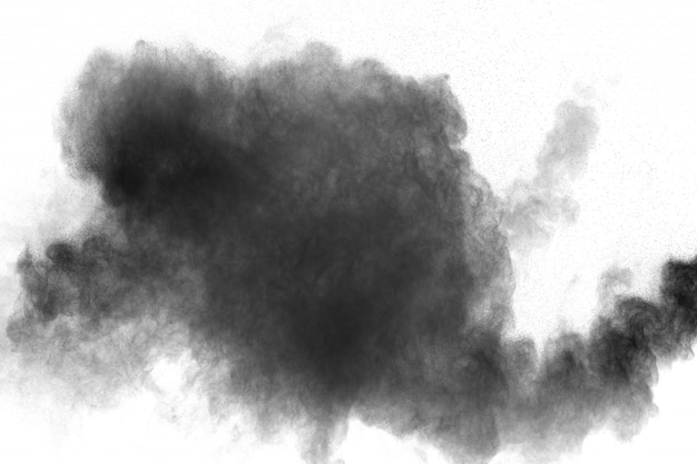 Black powder explosion against white background. black dust particles splashing.