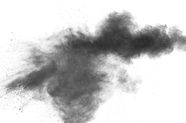 Black powder explosion against white background.charcoal dust particles cloud.
