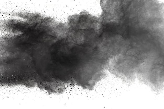 Black powder explosion against white background