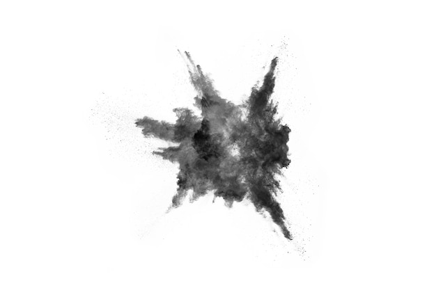 Black powder explosion. closeup of black dust particles explode isolated on white backgrou