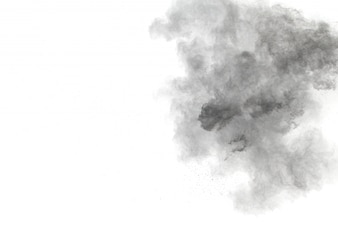 Black powder explosion on white background. Black dust particles splash.
