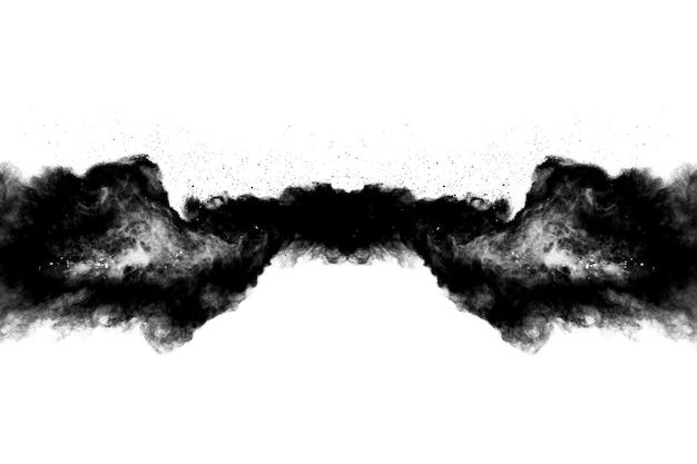 白い背景の上の黒い火薬の爆発