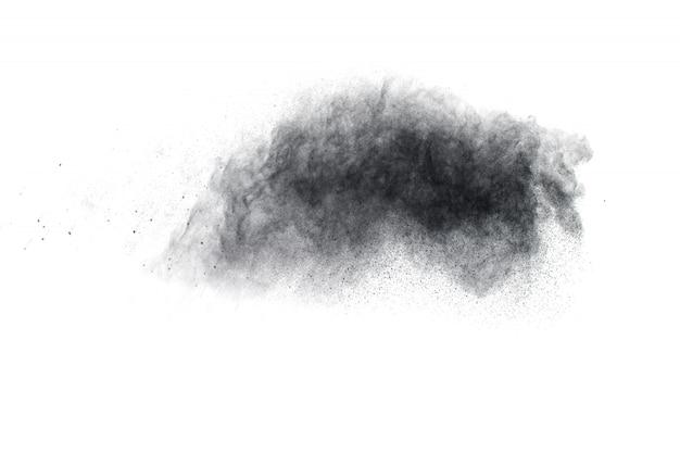 Black powder explosion on white background.