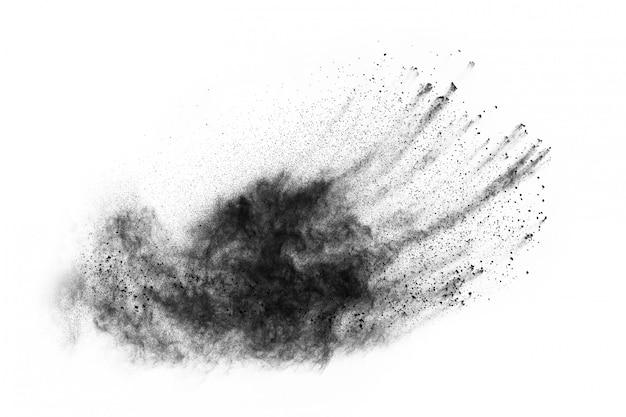 Black powder splatted on white background.