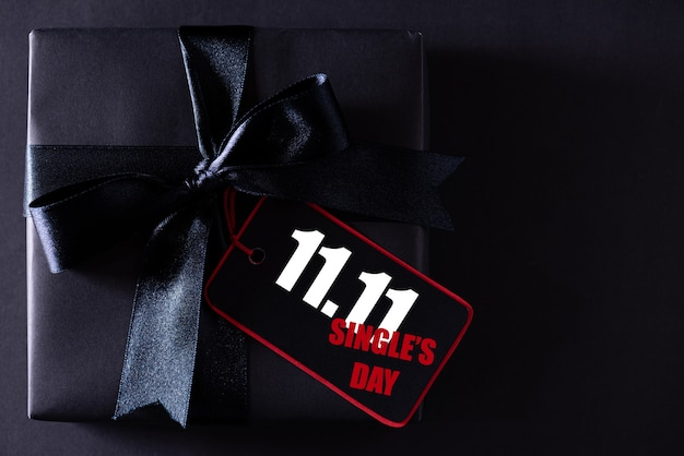 Black present with ribbon for single's shopping day
