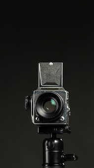 Black professional camera in a minimalist studio