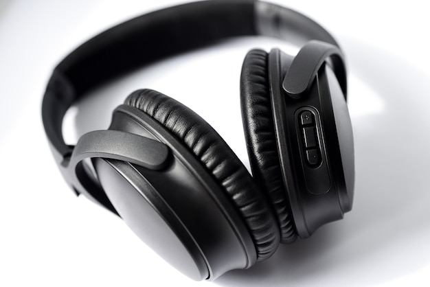 Black professional headphones on white.