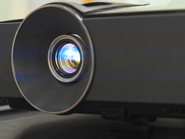 Black projector on black table, close up.