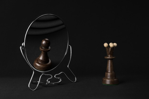 Black queen sees black pawn in the mirror