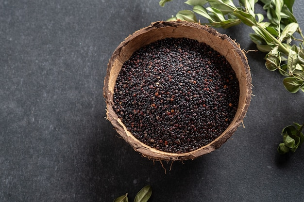 Black quinoa on dark texture