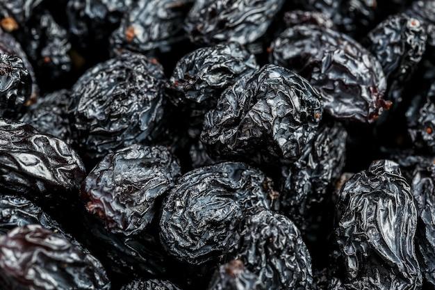 Black raisin texture, popular dried fruit. dried grapes.