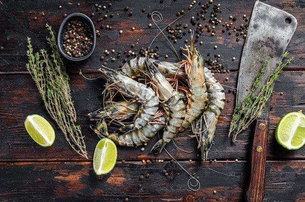 Black raw tiger prawns, shrimps with thyme and pepper.