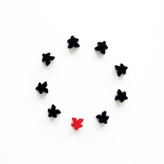 Black and red meeple board game pieces