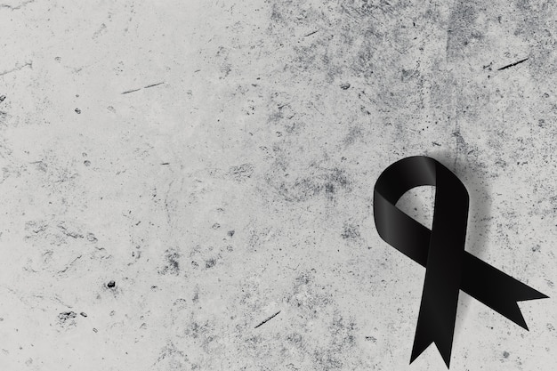 Black ribbon on concrete wall with space for text