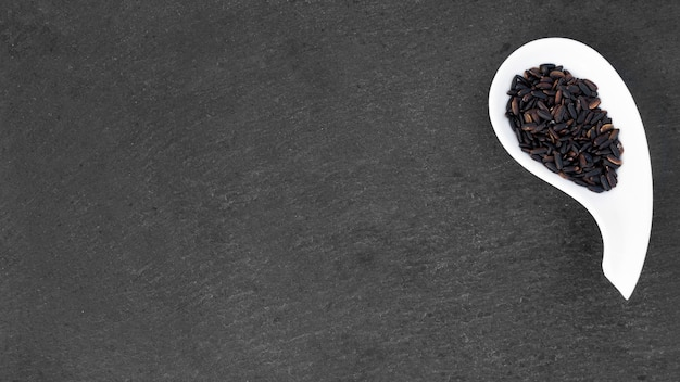 Black rice in bowl on table