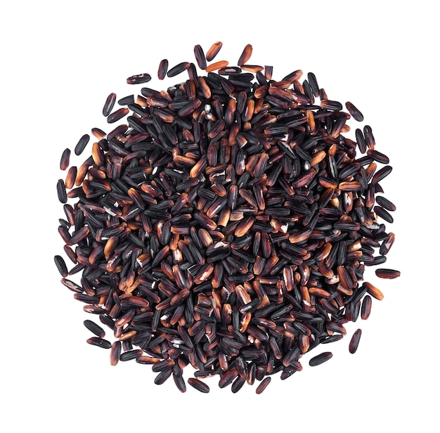 Black rice isolated on white background. top view