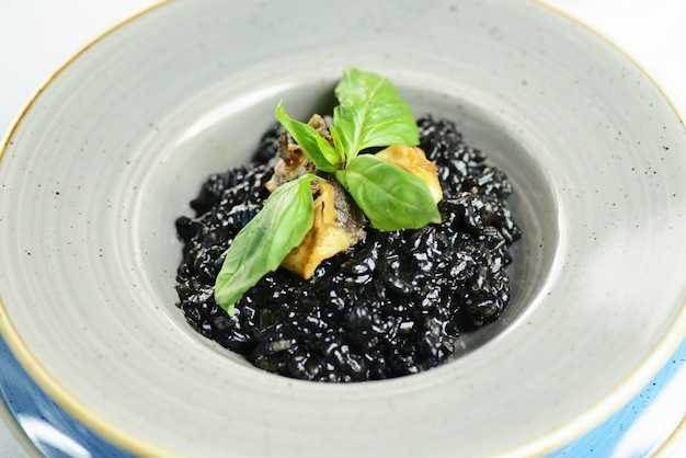 Black rice risotto with fish and basil