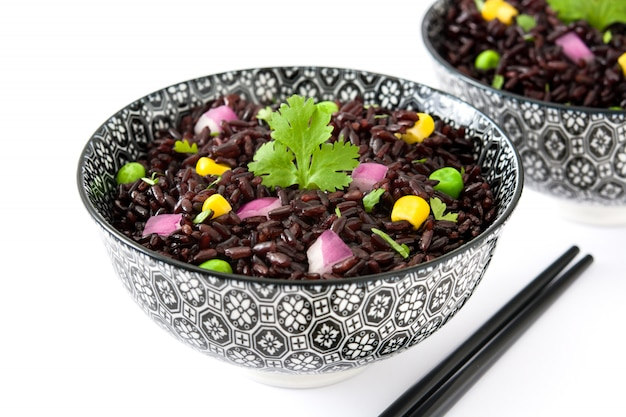 Black rice and vegetables isolated on white